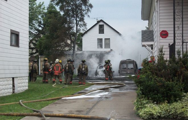 Buffalo fire officials did not report any injuries, but said the fire in the city's Delavan-Eggert section broke out a little past 6:30 a.m. and spread from the main garage at 98 Freund before extending to the home there. (David F. Kazmierczak / News Contributor)