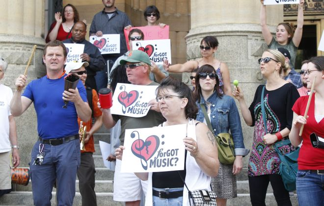 Supporters of music education rallied on the steps of City Hall Wednesday.(Harry Scull Jr./Buffalo News)