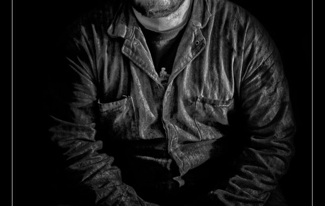 """The Steelworker,"" a photograph by Phil Pantano on view as part of his exhibition ""The American Worker"" in Main Street Studios."