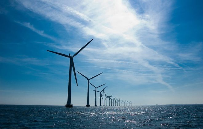 A row of turbines stretches toward the horizon at the Middelgrunden offshore windmill farm outside Copenhagen, Denmark. A similar development with six turbines is planned near Cleveland.
