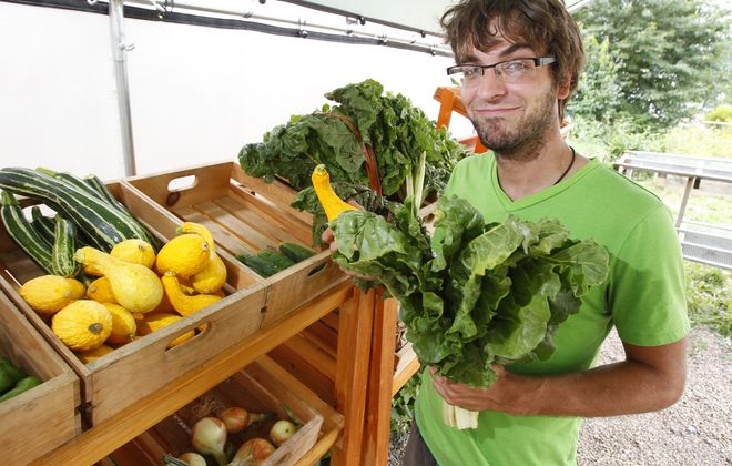 """""""We want to make people know that food has value.   It isn't something that just gets handed to you."""" — Tyler Manley, Mobile Market director for the Massachusetts Avenue Project"""