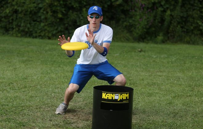 Eric Klavoon, of Wheatfield, demonstrates the technique he used with competing with his brother, Dan, as The Rebel Survivors in the KanJam World Tournament at the Gratwick Hose Company picnic grounds in North Tonawanda.