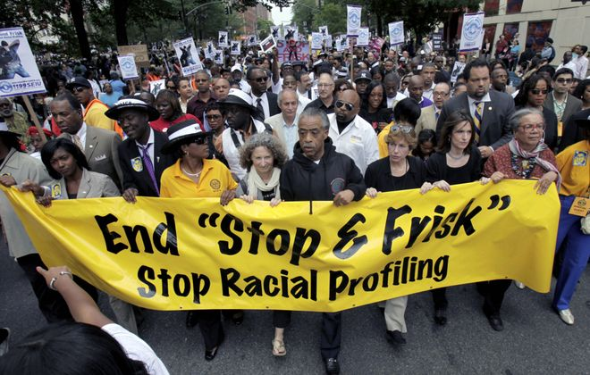 The New York Police Department's stop-and-frisk program has long been the target of civil rights demonstrators, including this march June 17, 2012, led by the Rev. Al Sharpton. (AP photo)