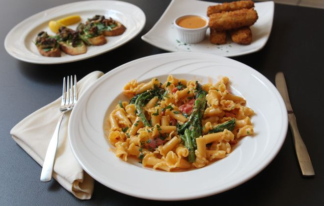 This is the grilled octopus at Osteria 166 is the new restaurant at 166 Franklin St. in downtown Buffalo.  In the foreground is the entree sausage campanelle and from left behind are appetizers grilled octopus and stuffed pepper risotto Cakes, Monday, Aug. 19, 2013.  (Sharon Cantillon/Buffalo News)
