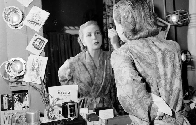 "In 1952, Julie Harris applies makeup for role as Sally Bowles in Broadway play ""I Am a Camera."""