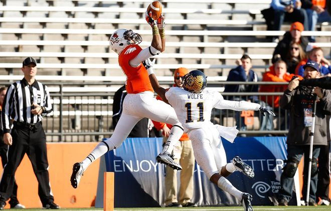 Bowling Green wide receiver Shaun Joplin, above, and Toledo running back David Fluellen will be key players in their divisions.   COLUMBUS, OH - NOVEMBER 17:  Shaun Joplin #9 of the Bowling Green Falcons catches a touchdown pass over Norman Wolfe #11 of the Kent State Golden Flashes on November 17, 2012 at Doyt Perry Stadium in Bowling Green, Ohio. Kent State defeated Bowling Green 31-24. (Photo by Kirk Irwin/Getty Images)