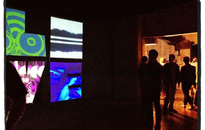 Visitors to the inaugural version of the City of Night arts festival explore a video installation by VJ Deliria inside a grain elevator at Silo City.