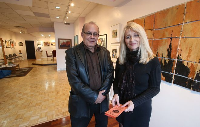 George Grace and partner Nancy C. Mariani in their Meridian West Art Gallery on Hertel in Buffalo on3 of the largest galleries to open in recent years.