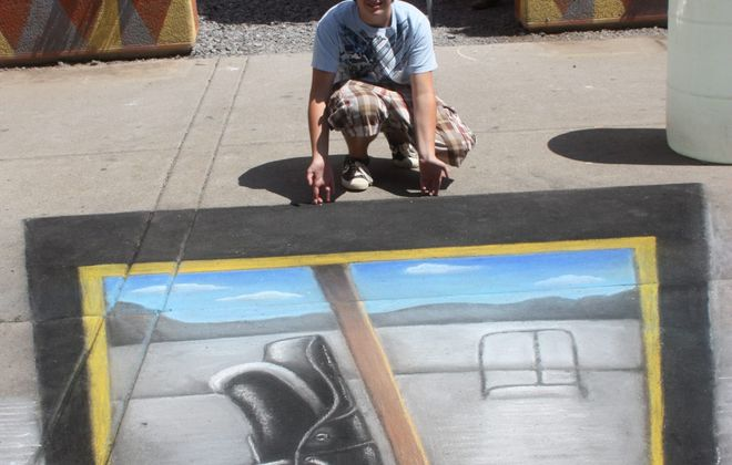 A visitor to the 2012 Buffalo Chalk Fest poses with Michael Macauley's tribute to the Buffalo Sabres.