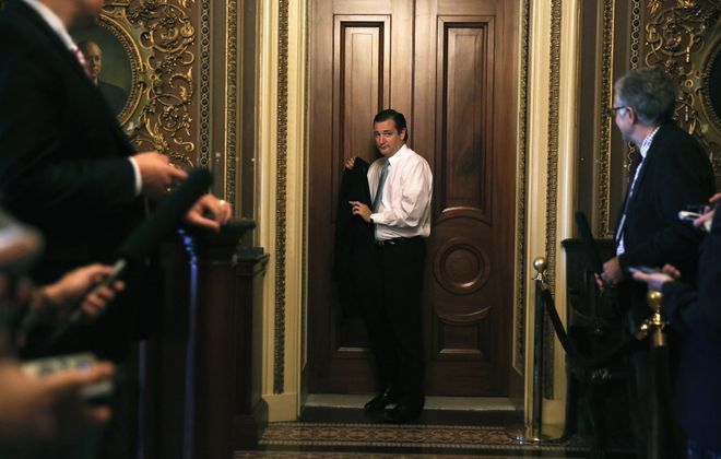 As media await, Texas Sen. Ted Cruz departs GOP policy luncheon on Capitol Hill en route to Senate floor, where Tuesday he began a filibusterlike effort to defund Afforable Care Act and perhaps precipitate a government shutdown next week.
