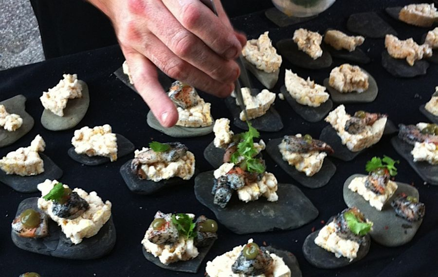 Chef assembles appetizer of poached shrimp, burnt nori, kaffir matcha gel, cilantro and rice puff at Silo City.  (Photo by Lauren Newkirk Maynard)
