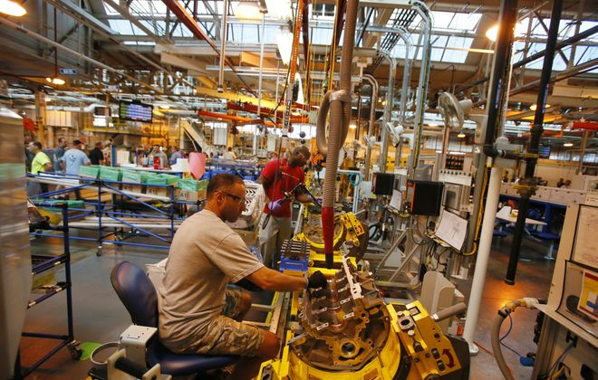 Work at local factories continued to increase in August. The GM Powertrain plant in Tonawanda has been busy, as was apparent during its 75th anniversary celebrations last month. (Derek Gee/Buffalo News)