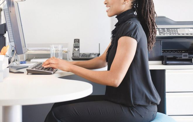 Sitting on an exercise ball at your desk can keep you invigorated at work.
