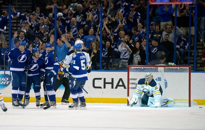 Lightning Tyler Johnson, middle, celebrates his first-period goal against the Sabres. Tampa Bay won, 3-2.