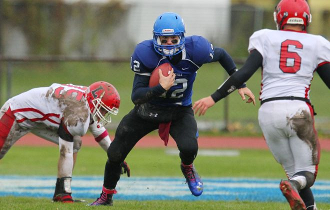 Senior quarterback Adam Fron (12) and Kenmore West got through Lancaster (Tom Heist, left, and Tyler Lis, right) to earn a semifinal matchup at top-seeded and top-ranked Jamestown next week.