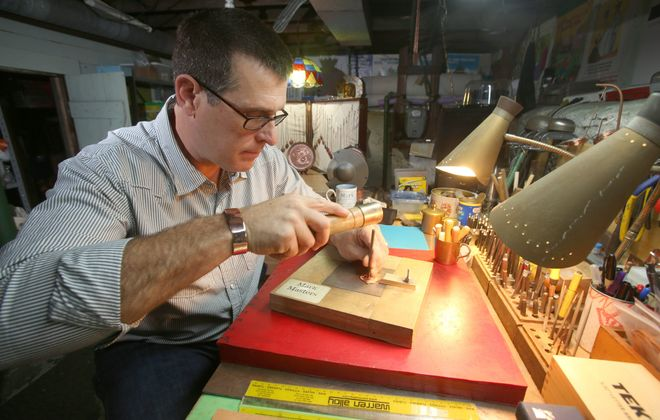 """""""Fear almost kept me from pursuing it,"""" said artist Mark Masters, shown working in the basement studio of his North Buffalo home, of the craft that has become a major passion in his life."""