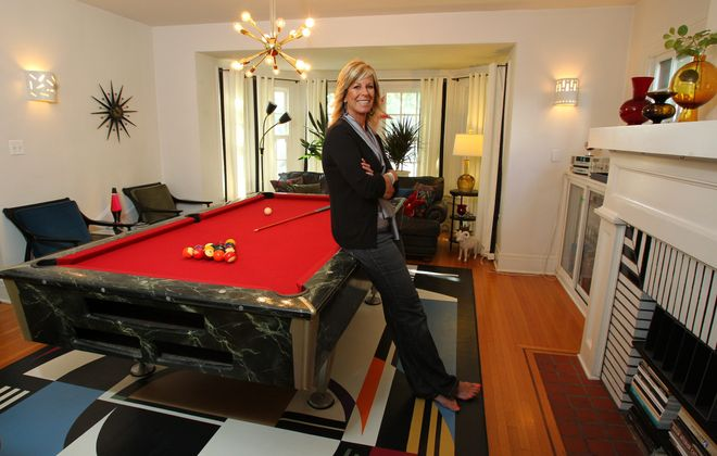 Sandy Nelson, in the party room at the Kenmore home she shares with her husband, Tim, and two dogs. The funky space was once a living room.