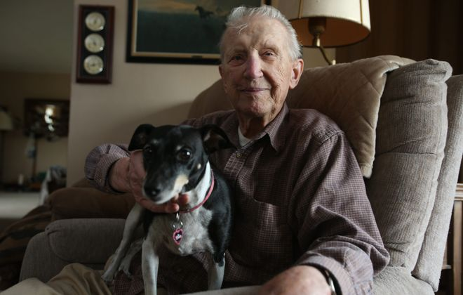 Harry Wisniewski, with dog Mollie, recalls preventing a U.S. plane from being shot down by friendly fire.