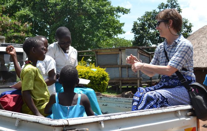 Anne Wadsworth, founder of the Buffalo-based Girls Education Collaborative, visits with youngsters in Tanzania during one of her many visits there.