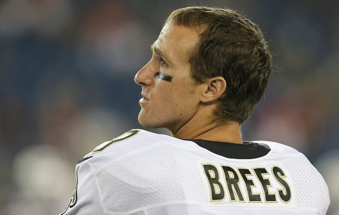 FOXBORO, MA - AUGUST 9:   Drew Brees #9 of the New Orleans Saints watches from the sideline during a preseason game against the New England Patriots in the first half at Gillette Stadium on August 9, 2012 in Foxboro, Massachusetts. (Photo by Jim Rogash/Getty Images)
