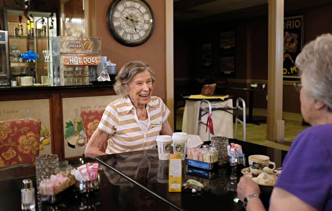 Lenore Jorgensen enjoys coffee with another resident at Edgemere, a senior living community in Dallas.