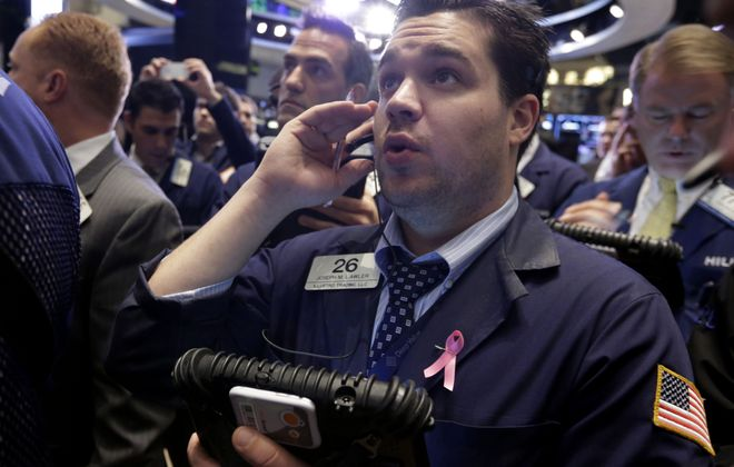 """Joseph Lawler, foreground, a trader on New York Stock Exchange, keeps a close eye on how worldwide jitters about U.S. fiscal crisis may be affecting investor confidence. Even with all its problems, U.S. is still seen as """"the best of the worst."""""""