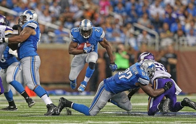 Lions running back Reggie Bush found plenty of room against the Vikings, finishing with 191 yards on offense. (Getty Images)