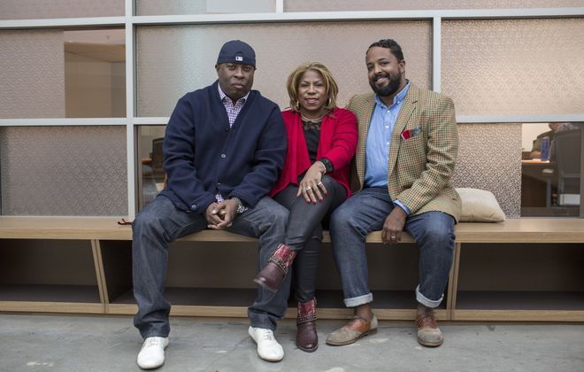 Vince Wilburn Jr., left, sits with his cousins Cheryl Davis and Erin Davis, children of Miles Davis. The three are heirs to Davis' estate, and they are working to keep alive the music of the famous jazz trumpeter.