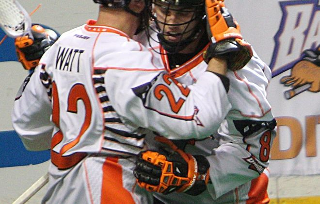 Kevin Brownell receives congratulations from Andrew Watt after scoring his second-period goal for the Bandits.