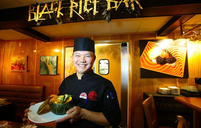 """Chef/owner Kevin Lin holds the """"Shwe PayonThi Hin"""" Pumpkin Stew at Sun Restaurant Buffalo."""