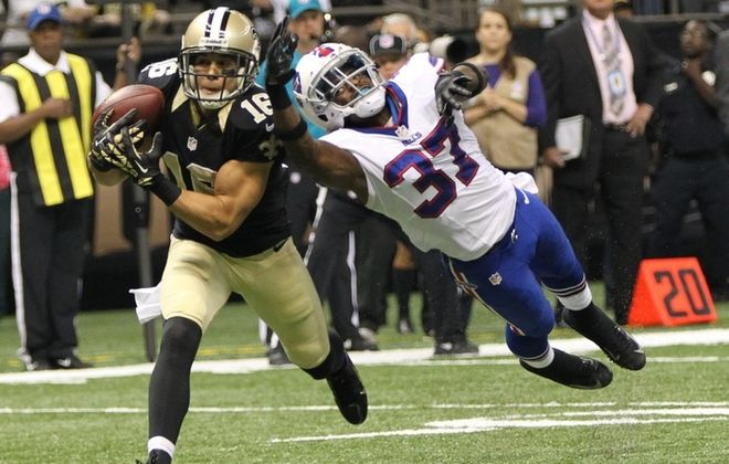 Saints receiver Lance Moore beats Bills defensive back Nickell Robey for a 15-yard touchdown catch on a pass from Drew Brees in the first quarter. (James P. McCoy/Buffalo News)