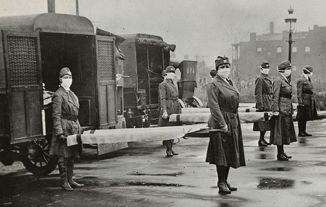 Members of the St. Louis Red Cross Motor Corps on duty on five ambulances during the 1918 flu pandemic. (Library of Congress)