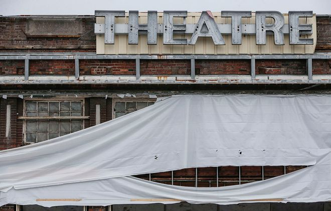 A portion of the old Record Theatre sign remains as the building undergoes initial phases of reconstruction on Main Street on Tuesday, Jan. 21, 2020. (Derek Gee/Buffalo News)