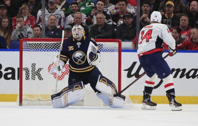 Buffalo Sabres goaltender Linus Ullmark celebrates a victory after stopping Washington Capitals player Richard Panik during a shootout at the KeyBank Center, on Monday, March 9, 2020. (Harry Scull Jr./Buffalo News)