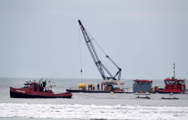 Crews start to remove the ice boom from Lake Erie in Buffalo on Monday, March 1, 2020. (Mark Mulville/Buffalo News)