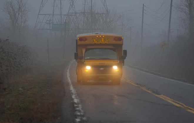 A school bus emerges from the fog on North Forest Road in Amherst, on Tuesday, March 3, 2020. (John Hickey/Buffalo News)