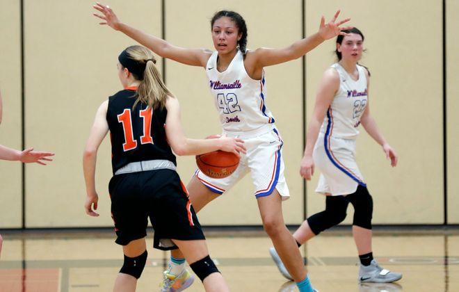 Williamsville South's Amari DeBerry (42) applies the defense shutting down Amherst's Emma Klein (11) during their Class A2 girls basketball semifinal game at Clarence Tuesday. (Robert Kirkham/Buffalo News)