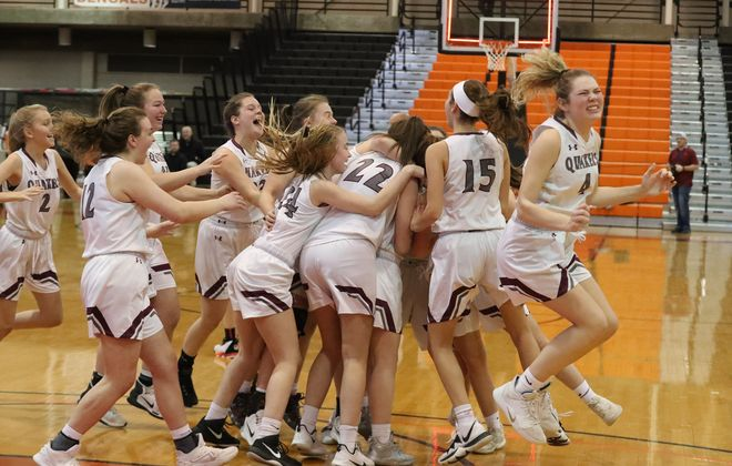 Orchard Park's Leah Harrigan is mobbed by her teammates after she scored a tying basket with no time left in regulation. Orchard Park beats Clarence 56-52 in over time to win the Class AA Championship at Buffalo State Sports Arena in Buffalo,N.Y. on Sunday March 8, 2020. (James P. McCoy/Buffalo News)