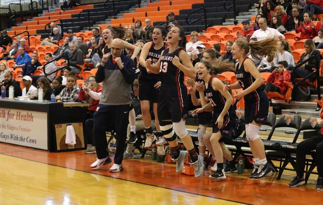 Southwestern's Gianna Hoose and her teammates jump in the air after beating Eden 54-44 to win the Class B-2 Championship at Buffalo State Sports Arena in Buffalo, N.Y., on Sunday March 8, 2020. (James P. McCoy/Buffalo News)