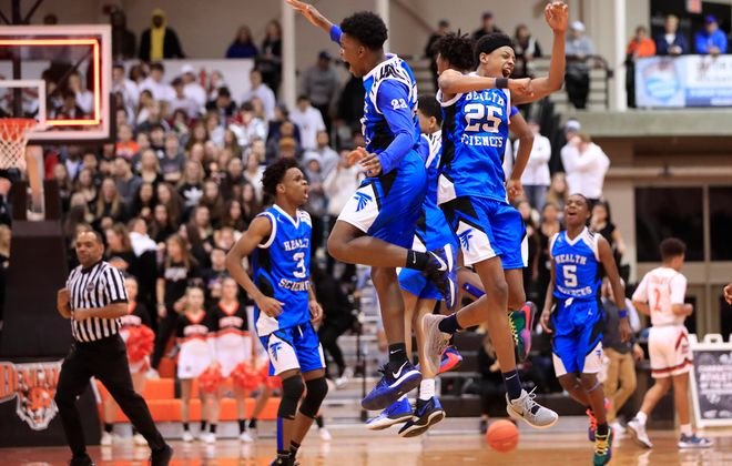 Health Sciences players celebrate a victory over Amherst during the Section VI,Class A2 Championship at the Buffalo State Sports Arena, on Saturday, March 7, 2020. (Harry Scull Jr./Buffalo News)