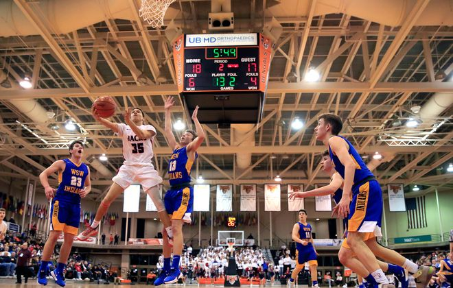 North Tonawanda player Jordan Cutter drives to the basket against West Seneca West during the first half of the Section VI,Class A1 Championship at the Buffalo State Sports Arena, on Saturday, March 7, 2020. (Harry Scull Jr./Buffalo News)