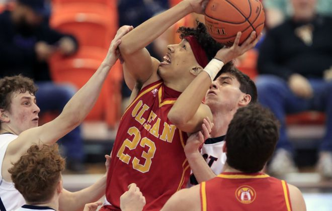 Olean player Jah'Karee McClain grabs a rebound against East Aurora during the second half of the Section VI,Class B1 Championship. (Harry Scull Jr./Buffalo News)