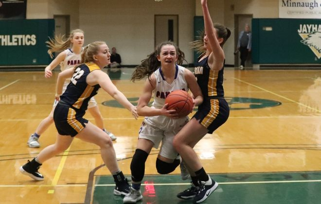 Panama's Mandy Brink scores two points over Sherman's Jenna Fisher in the first half of the Class D Championship at Jamestown Community College  in Jamestown ,N.Y. on Saturday March 7, 2020. (James P. McCoy/Buffalo News)