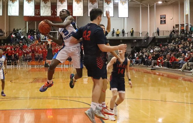 Health Sciences Ja'Vaughn Jones scores two points over North Tonawanda's Liam McMurray in the second half of the Boys Class A Crossover Championship game at Buffalo State Sports Arena in Buffalo,N.Y. on Tuesday, March 10, 2020. (James P. McCoy/Buffalo News)