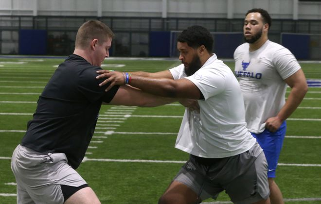 UB offensive linemen Evin Ksiezarczyk, left, and Tomas Jack-Kurdyla do a drill at Murchie Family Fieldhouse during Pro Day on March 11. (John Hickey/Buffalo News)