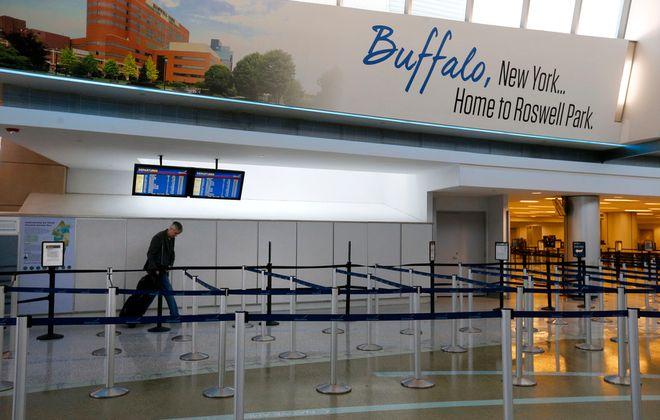 Travelers go through the TSA check point at the Buffalo Niagara International Airport on Tuesday.      (Mark Mulville/Buffalo News)