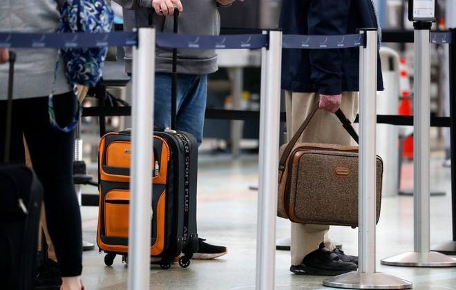 Travelers go through the TSA check point at the Buffalo Niagara International Airport Tuesday, March 10, 2020.      (Mark Mulville/Buffalo News)