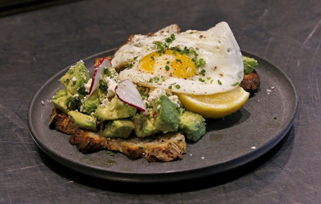 The avocado toast special is among the breakfast items at Elm Street Bakery in East Aurora. (Robert Kirkham/Buffalo News)