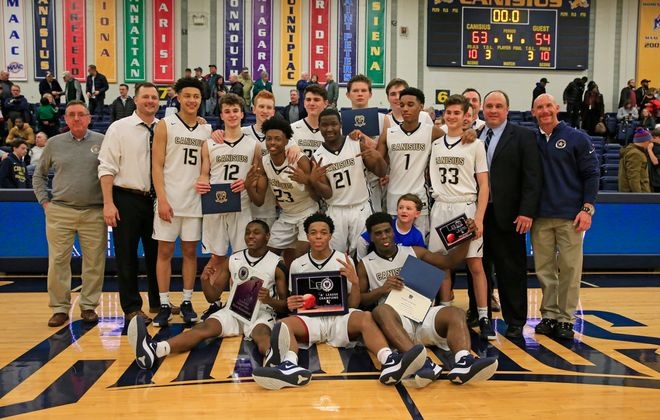 Canisius celebrates a victory over St. Joe's to win the Manhattan Cup Class A Championship game at the Koessler Center, on Tuesday, March 3, 2020. (Harry Scull Jr./Buffalo News)