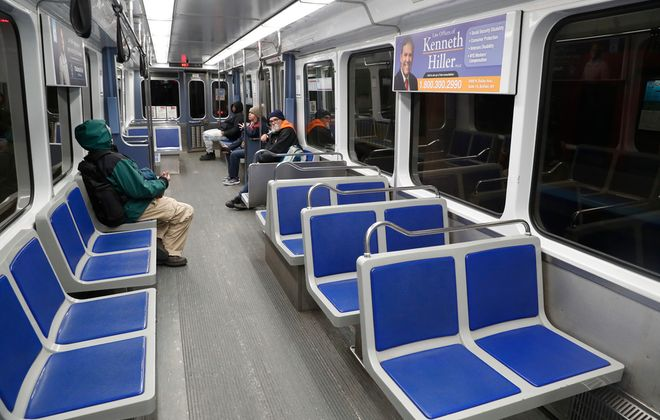 Riders on a Metro Rail train in Buffalo seem to be practicing social distancing on Tuesday, March 17, 2020. The Niagara Frontier Transportation Authority's trains are running on schedule but ridership is way down because of the COVID-19 virus scare. (Robert Kirkham/Buffalo News)